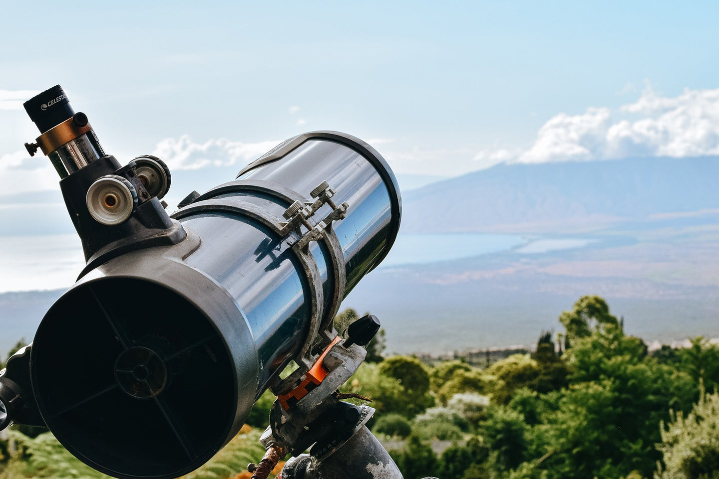 telescope pointed at a cloudy sky