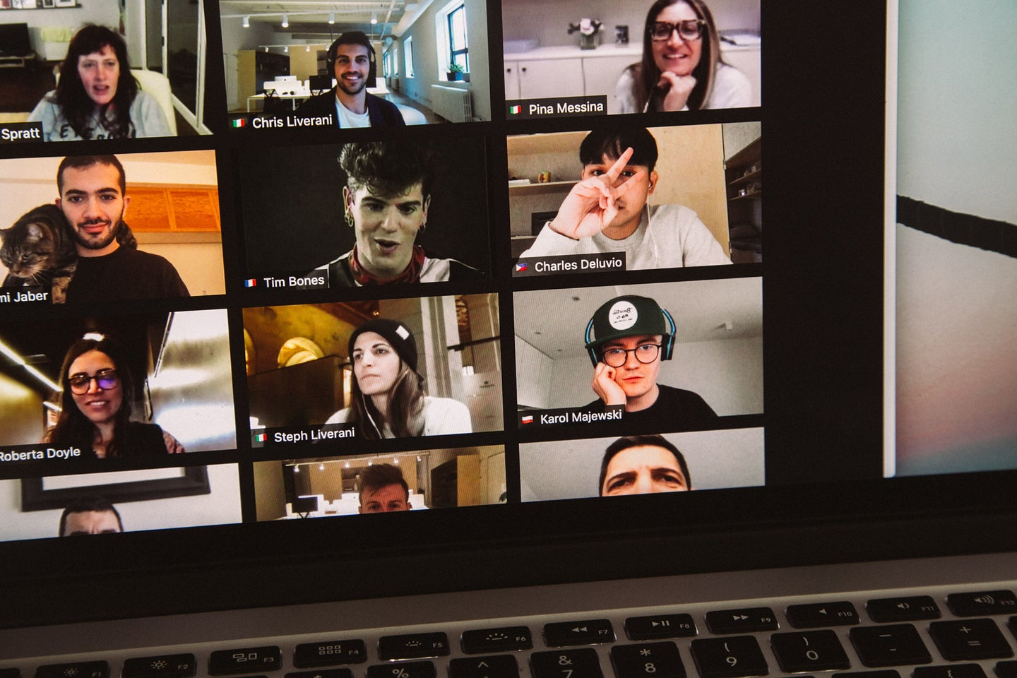 people on a zoom call on a laptop using the best laptop camera