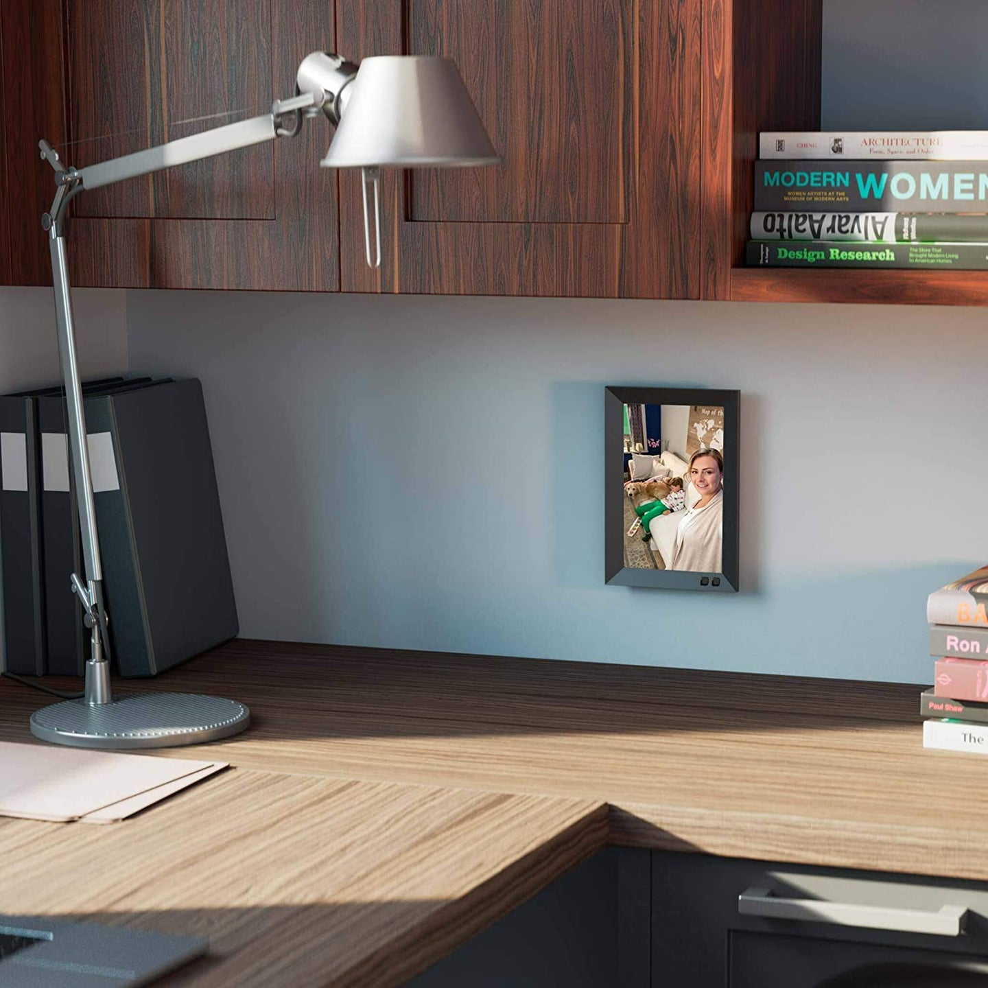 the best digital picture frame, lamp, and books on a desk
