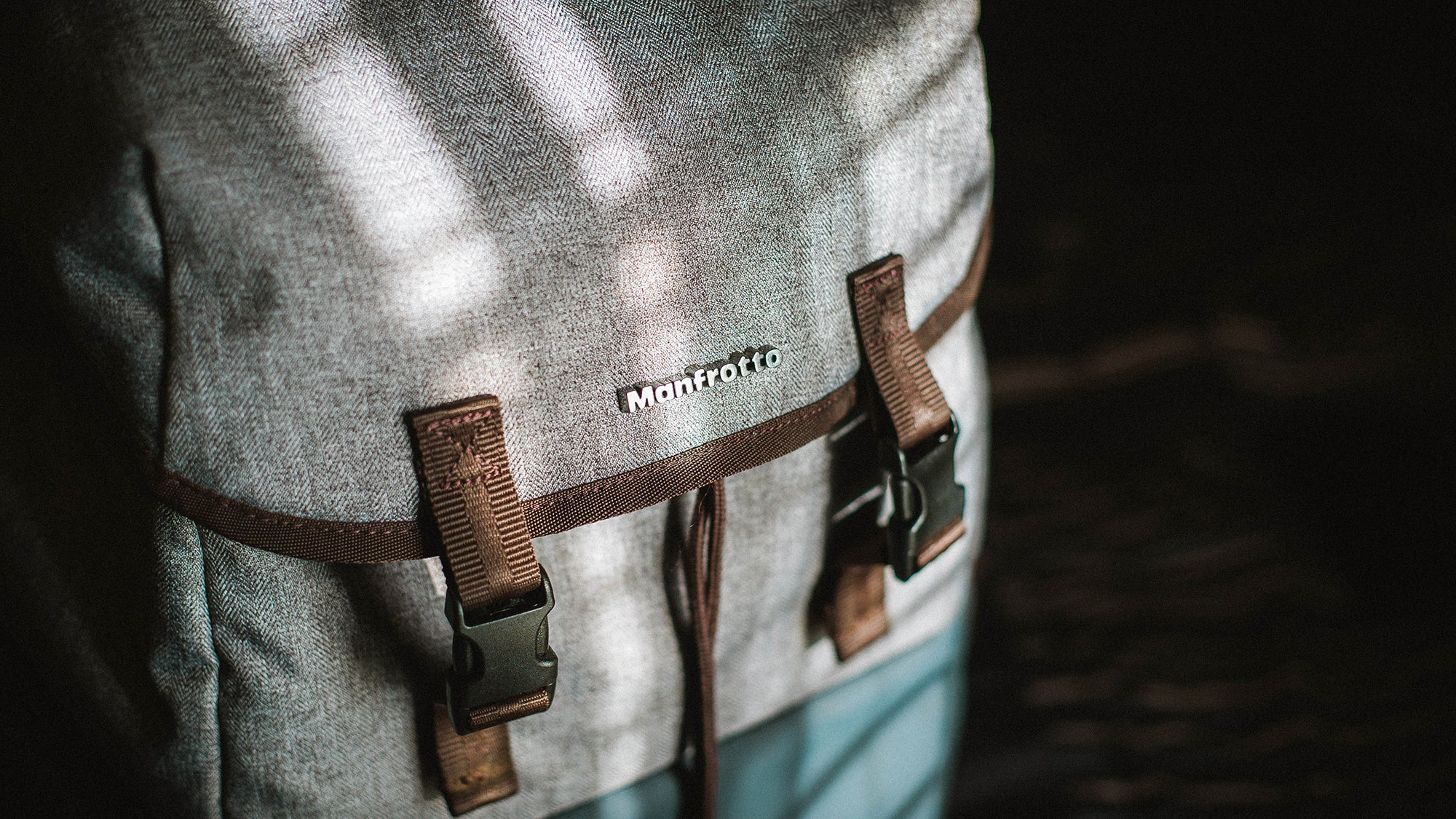 brown, grey, and blue Manfrotto bag with straps is one of the best camera bags