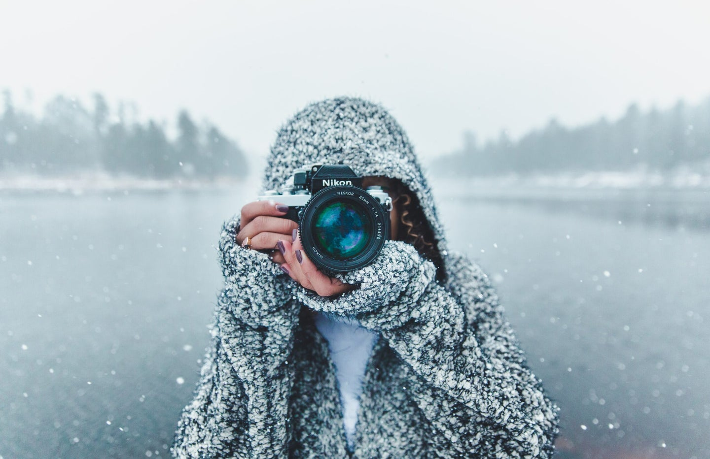 woman holding a camera - one of the best gifts for moms