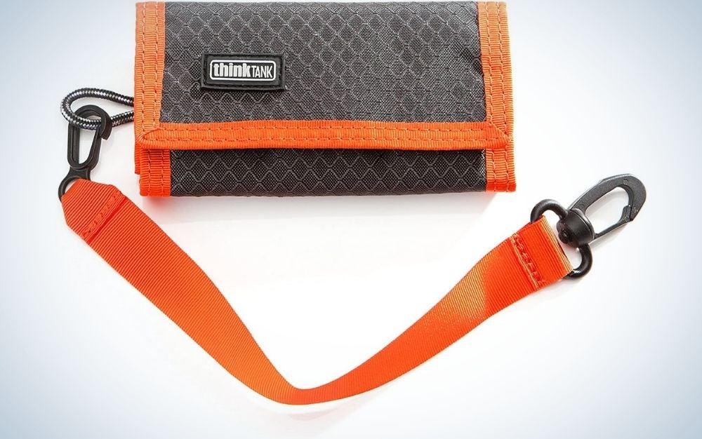 Small Think Tank black pocket with orange lanyard.
