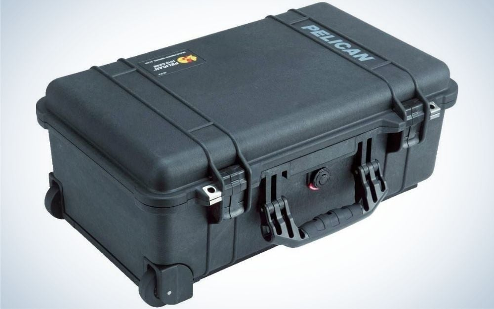 Black square Pelican suitcase with handle in it.
