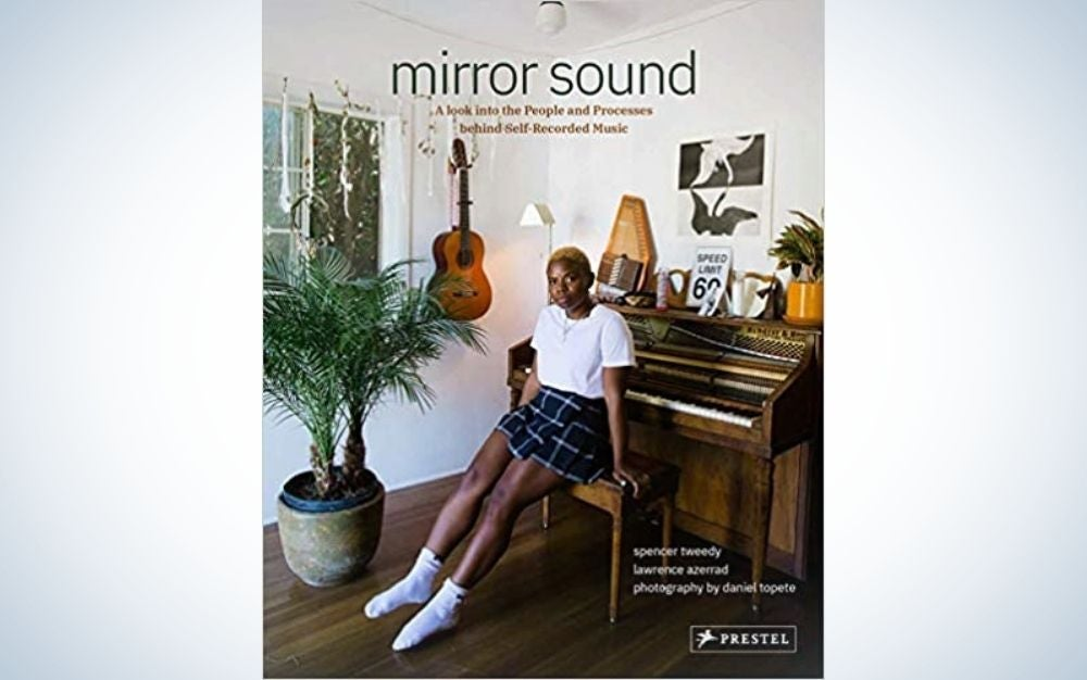 A book cover with a girl sitting on a piano bench is a great Father's Day gift for music lovers.