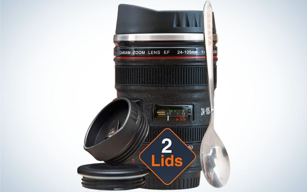 Camera Lens Coffee Cup written in front of it 2 Lids and a spoon in front of it.