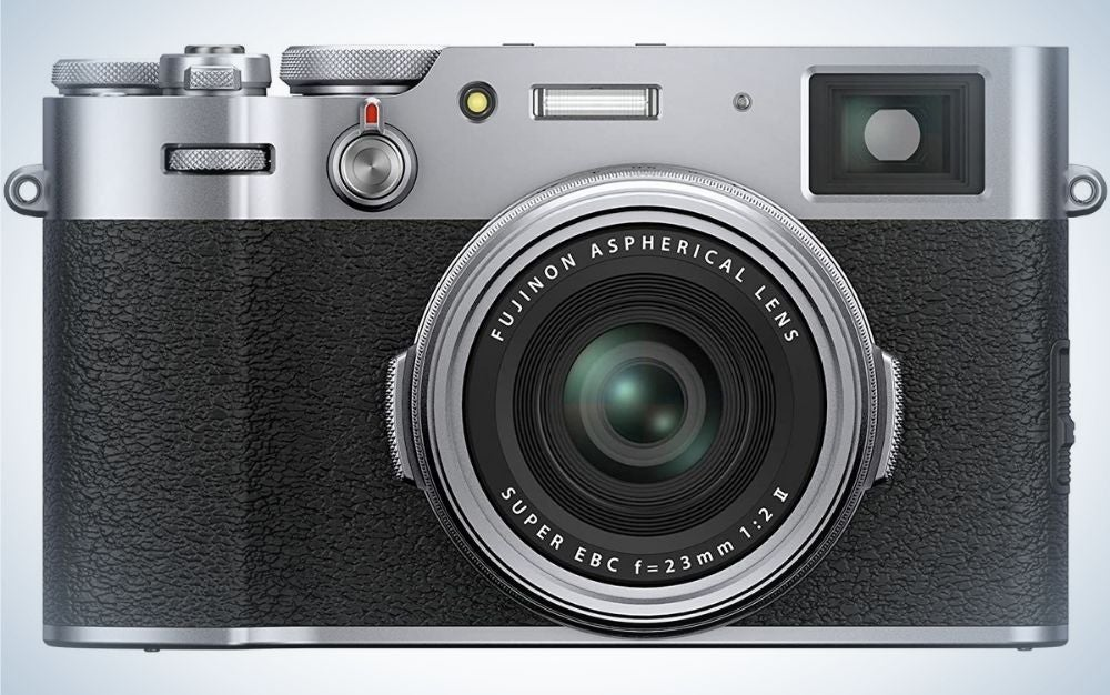 A Fujifilm camera with a black body and a silver head from the front.