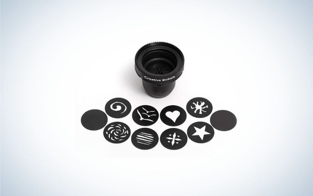 A black rounded Lens Bokeh Optic with different creative forms in front of it.