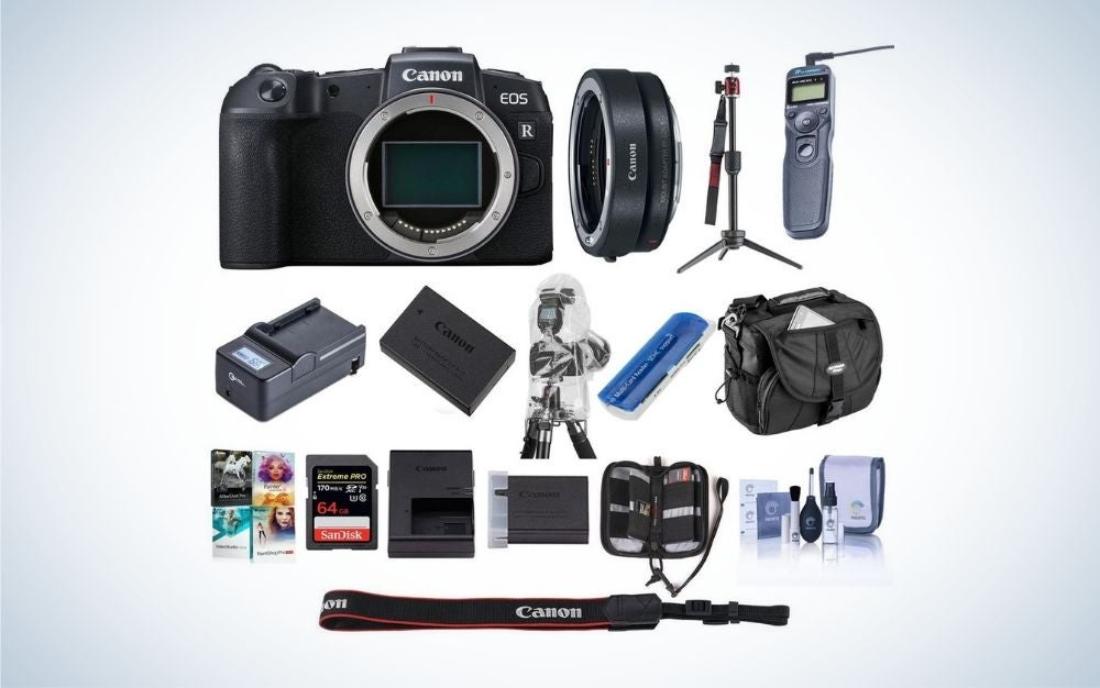 A black Canon camera mirrorless with all package of his set in one photo.