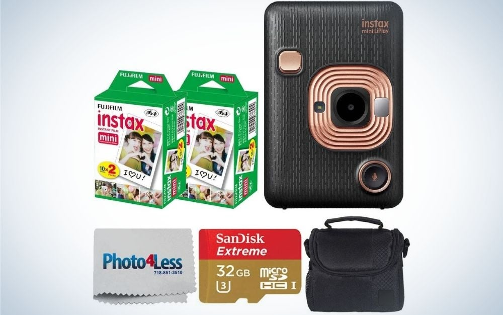 A black Fujifilm Instax Mini LiPlay Hybrid Instant Camera with two boxes in green Fujifilm Instax Instant Film, a grey Photo lens cleaner piece, a red and gold memory card and also a black compact camera case.