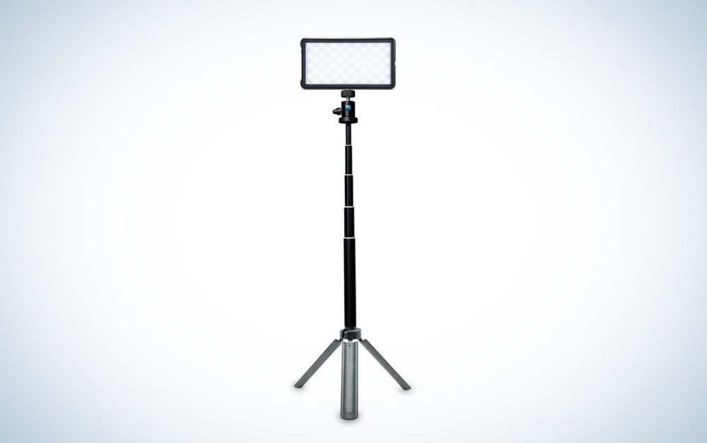 A broadcast lighting kit with a long holder stick with three legs as a support to ground.
