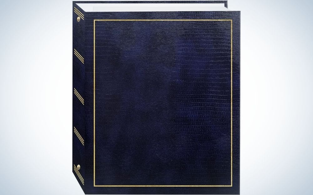 A square black book from the front with a golden font on it.