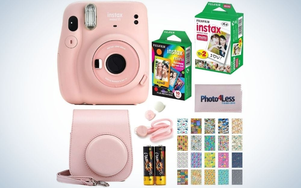 A pink mini camera with a full pack of sticker and two pairs of green batteries.