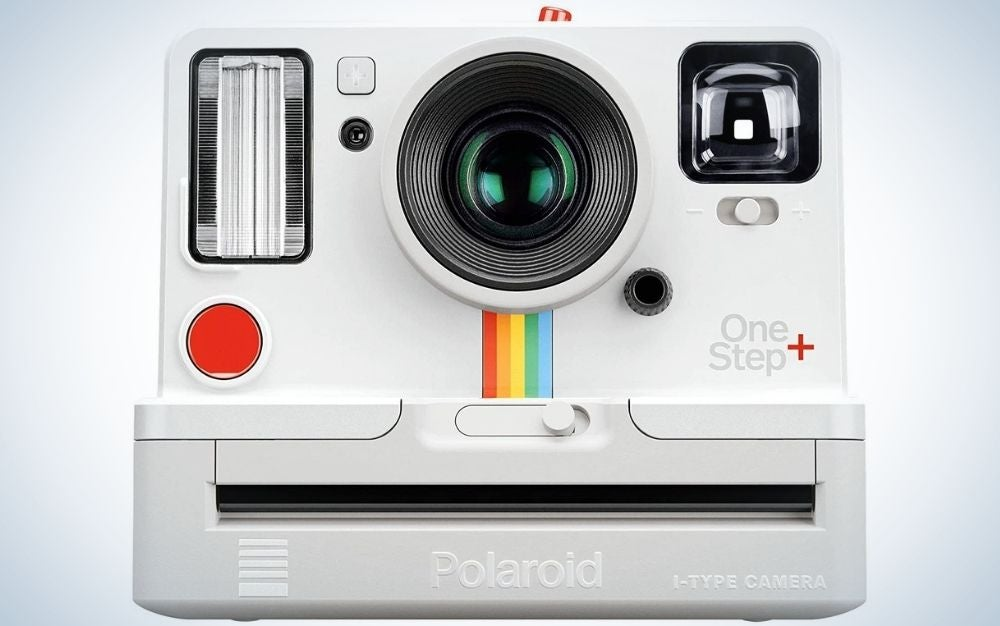 A white Polaroid professional camera with two lens and a flash.