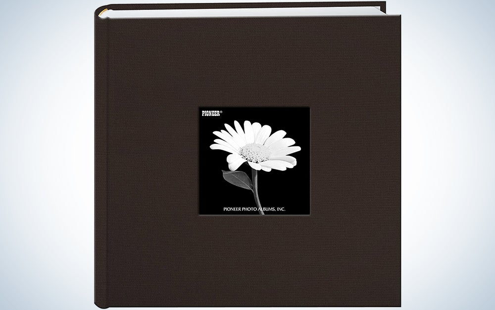 brown photo album with a black and white flower image in the center