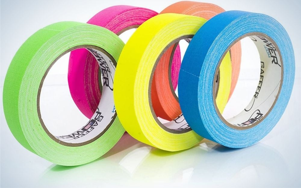 Five round adhesives in different colors such as orange, purple, blue, yellow and green.