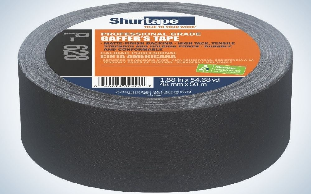 A thick black sticker with an orange inscription on top of it.