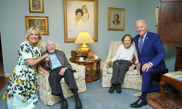 It's not simply wide-angle distortion making this photo of the Bidens and the Carters look weird