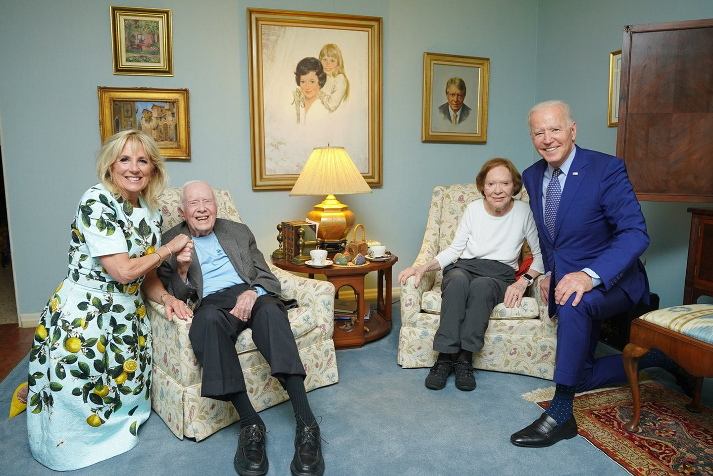 Bidens and the carters in a room