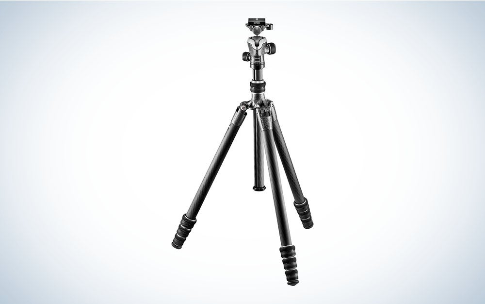 A carbon fiber tripod with three-section legs opened but not extended.