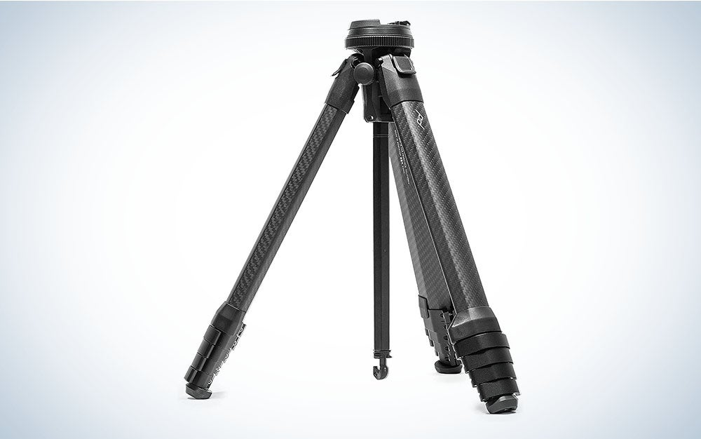 A carbon fiber travel tripod with the legs extended and weight hook down, ranked as the best travel tripod by us.