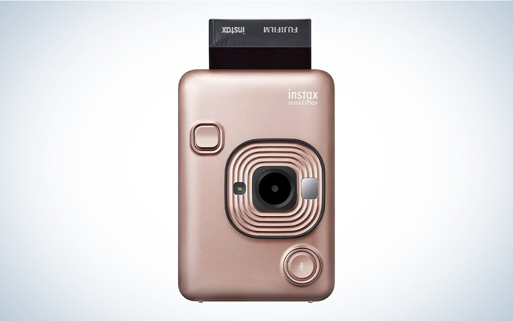A rose gold instant photo camera