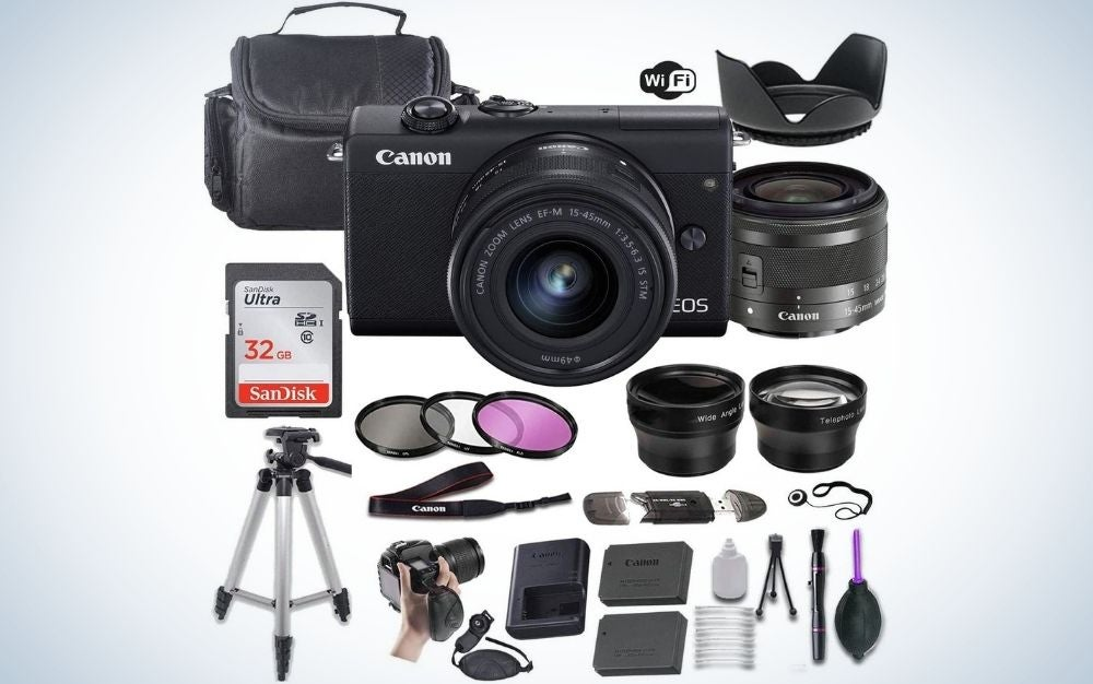 A professional camera with black color and with black lens in front of it, with portable tripod, memory card, lens, camera bag etc.