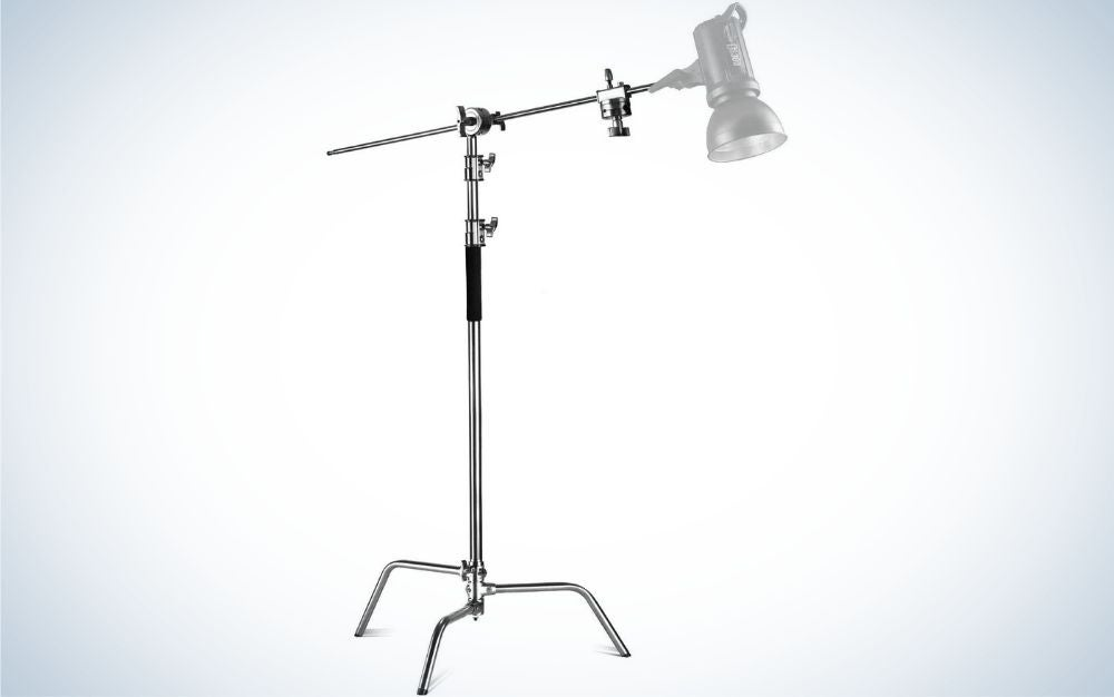 A hanging lamp with a simple gray head and a long holding rod with three metal legs.