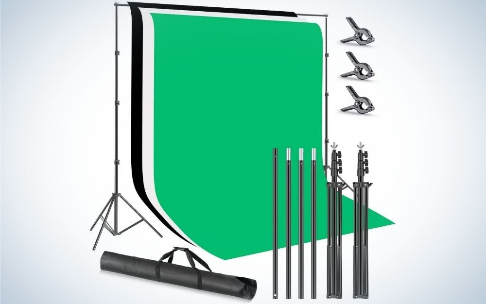 A square green field with some black sticks of different sizes and a bag that you can put inside the products for the next shot.