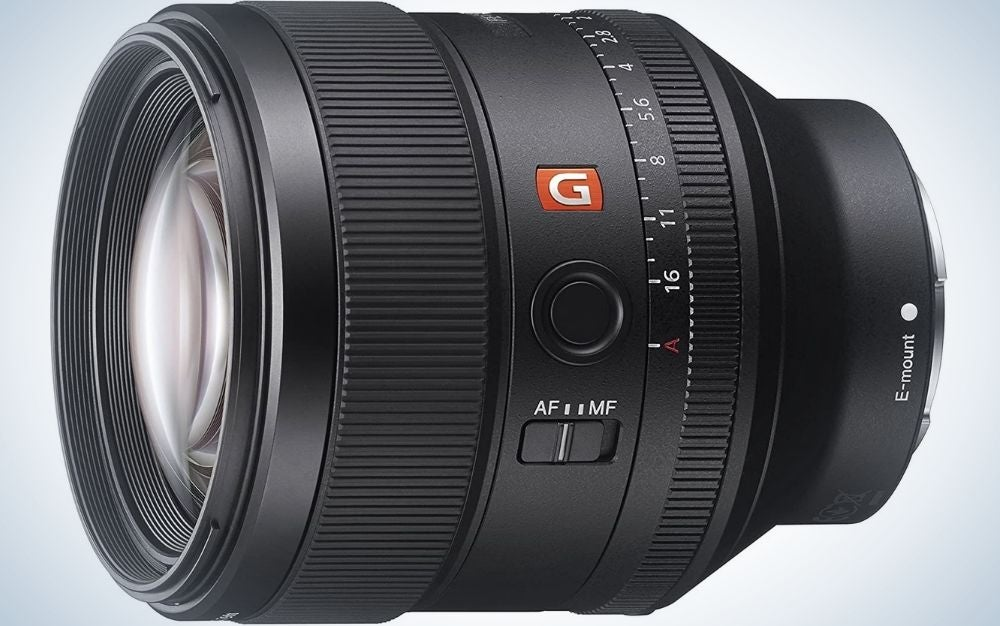 The lens of a professional camera positioned sideways and in a circular shape.