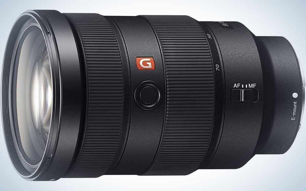 The lens of a professional camera positioned sideways and in a circular shape and with its longer body.