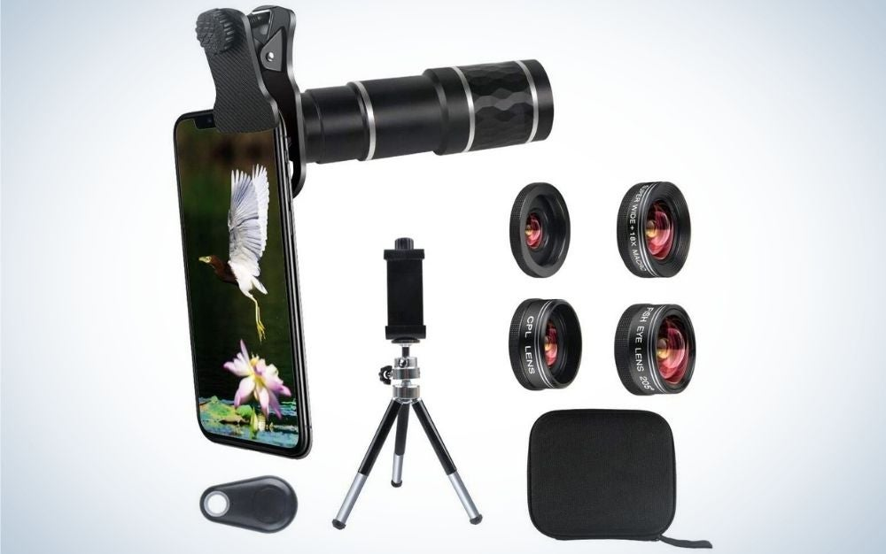 A black smartphone holder all with a cell case with a flower and a striped stork, as well as four different lenses, a three-legged holder and a small black square bag.