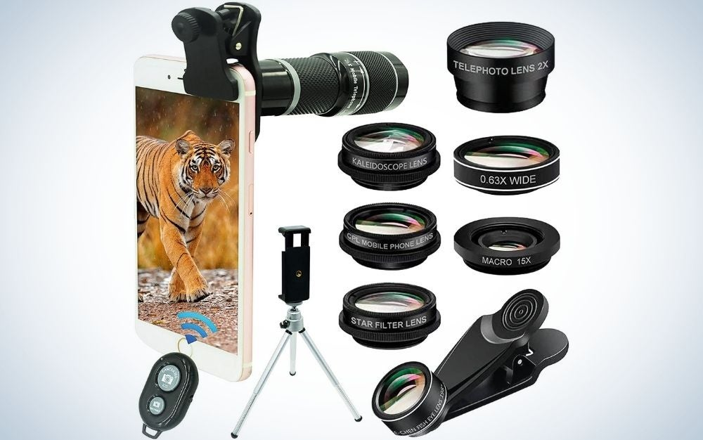 A black smartphone holder, on which stands a leopard shell phone, and several camera lenses lined up.