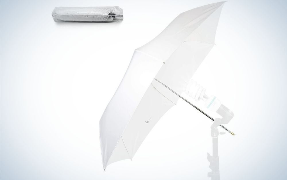 An open white umbrella all with a white stick and a white box on top.