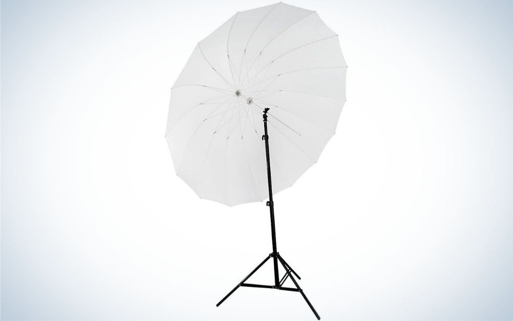 A large white umbrella with a thin stick holding a few black colored legs.