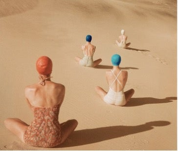 models-sitting-on-sand-dunes
