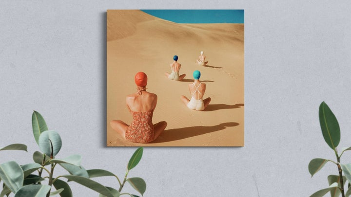 models-sitting-on-sand-dunes-canvas-on-wall