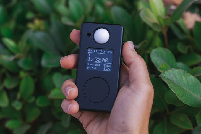 Negative Supply LM1 Light Meter in a hand in front of some plants