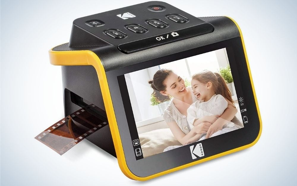 A black scanner with a small front screen and a photo on it, all black and with a thick yellow line on the back.