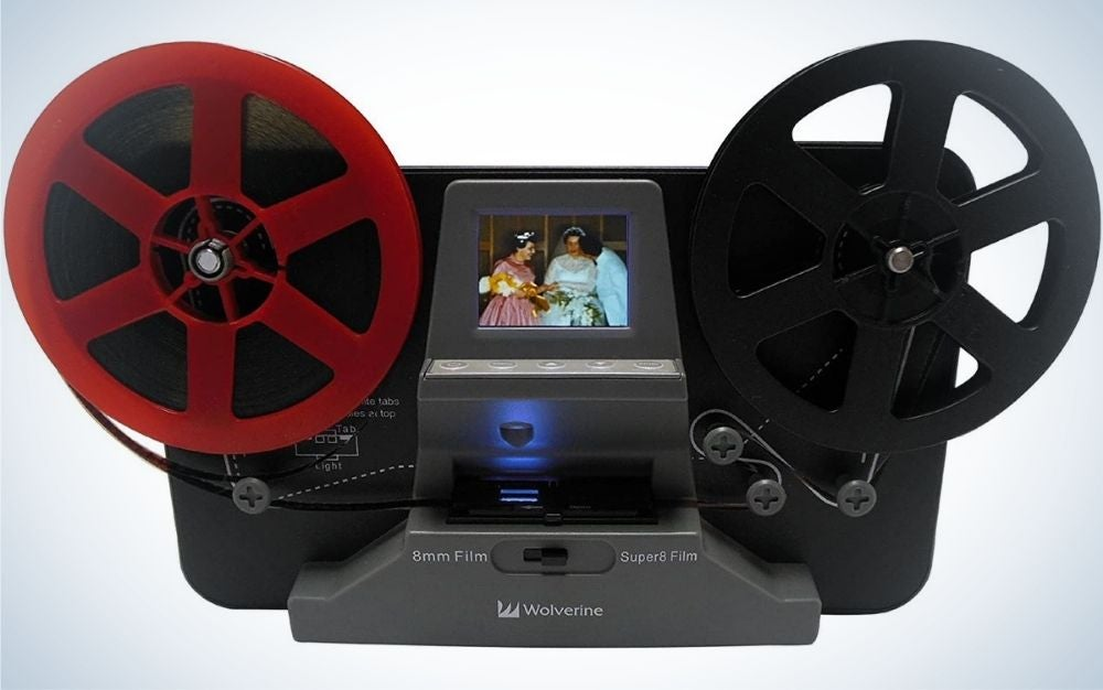 A Film reel converter scanner to convert film into digital videos with two wheels one color black and one color red, as well as in the middle of a small screen.