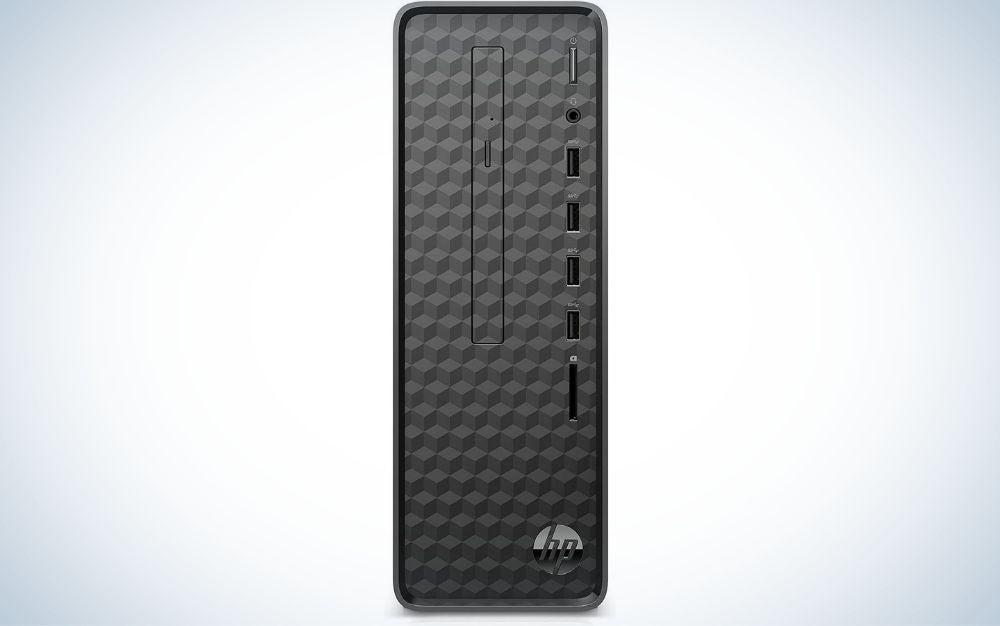 A black, narrow, rectangular desktop computer in front of it.