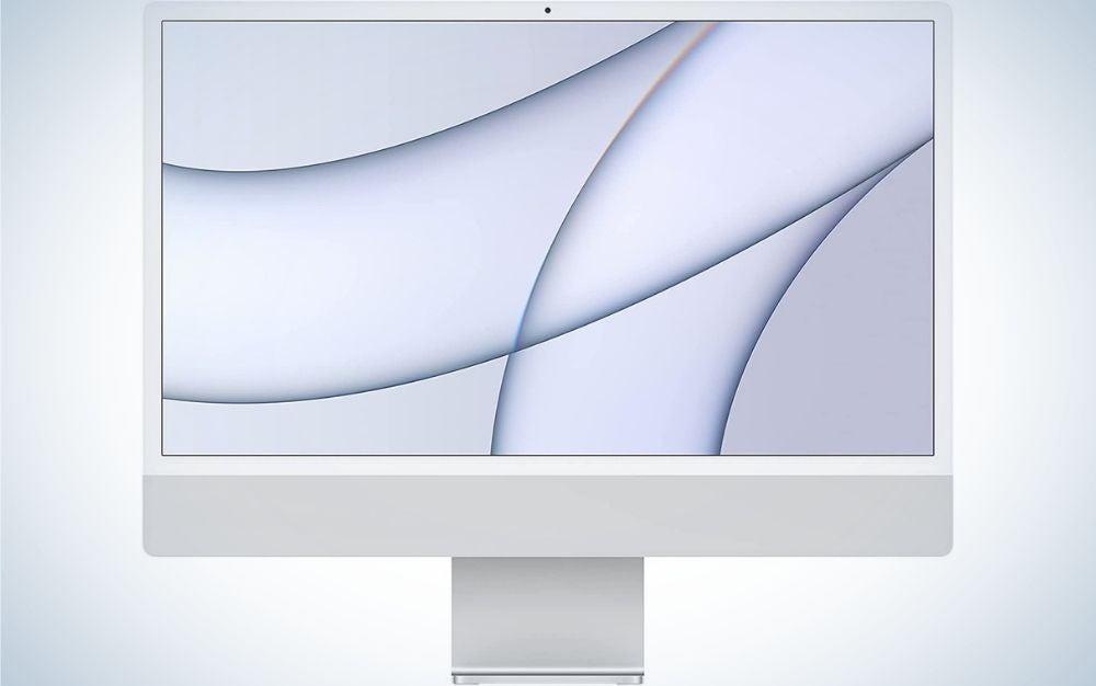 A white desktop with the Apple Mac mini brand mark.