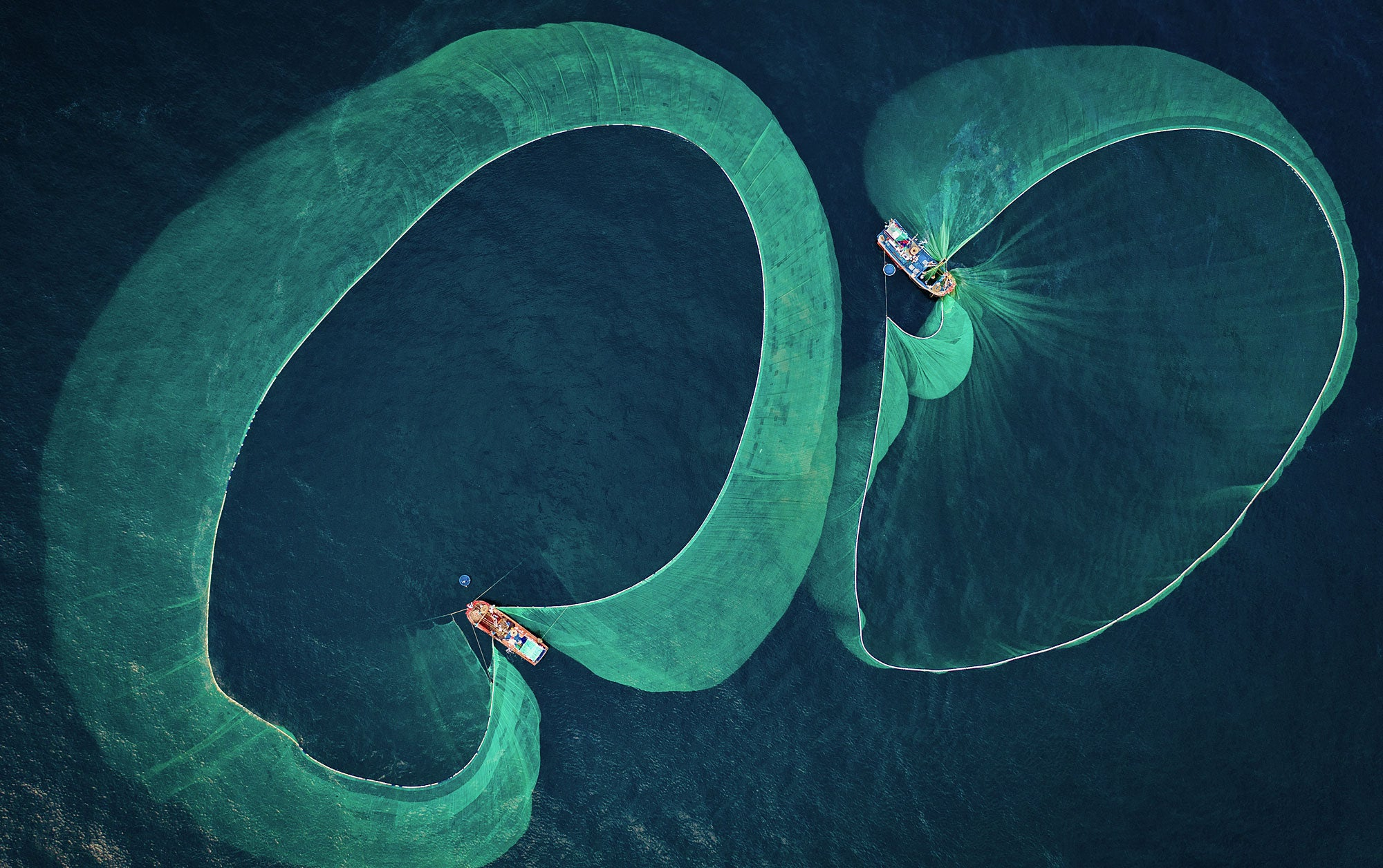 nchovy fishing boats photographed from above along the coastline