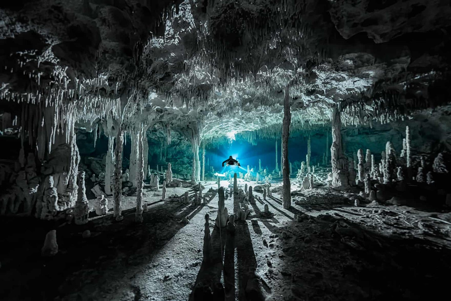 Speleothems cast long shadows at Cenote dos Pisos in Mexico