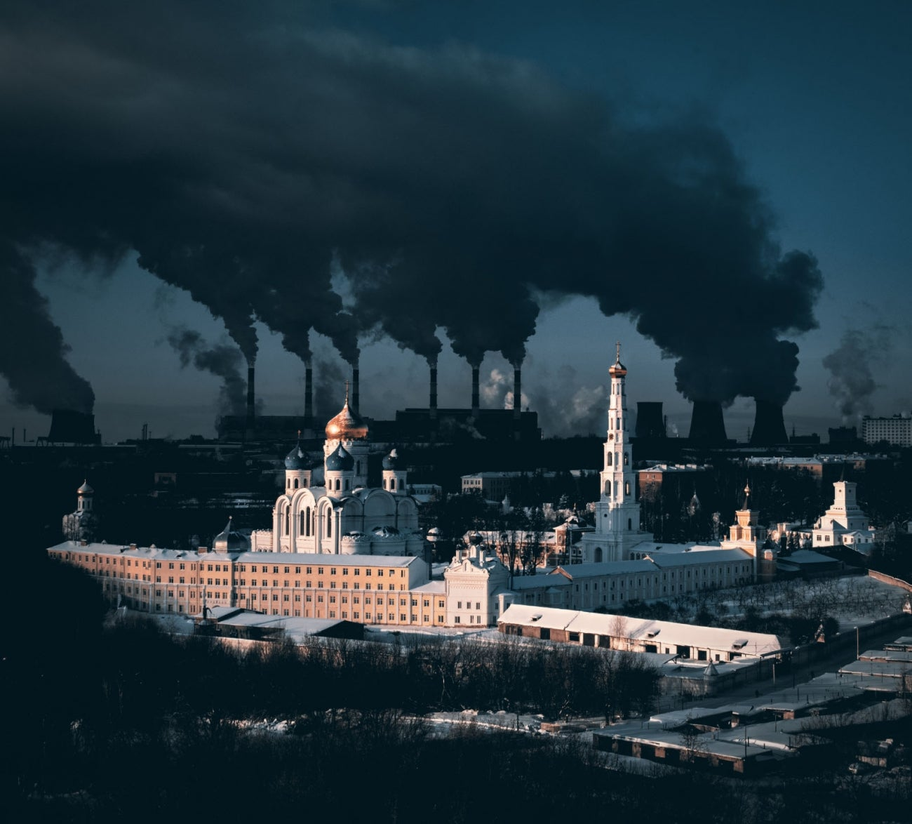 A 500-year-old monastery in the Moscow region and a large power plant in the background